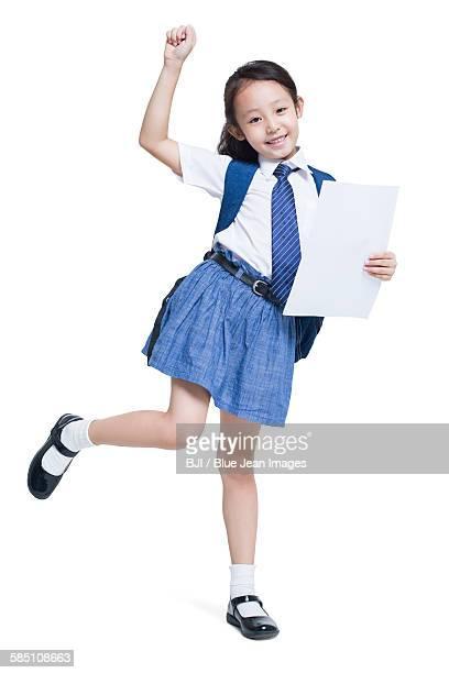 Happy schoolgirl with report card