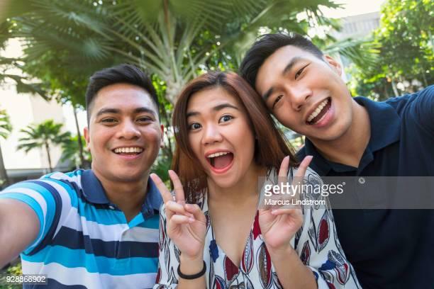 Happy selfie with friends