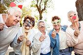 Happy senior adult women making faces