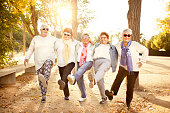 Happy senior adult women wearing sunglasses