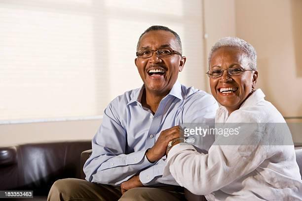 Happy senior African American couple wearing eyeglasses