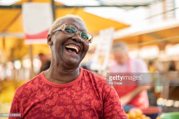 happy senior african ethnicity woman portrait - black people laughing stock photos and pictures