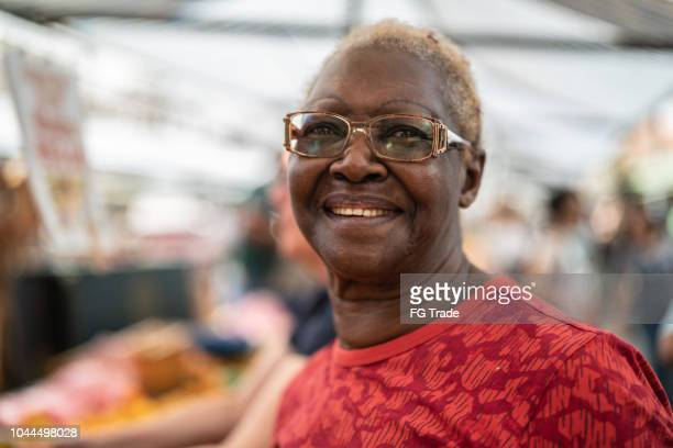 happy senior african ethnicity woman portrait - one senior woman only stock pictures, royalty-free photos & images