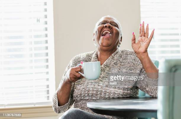 happy senior african-american woman at home, coffee - funny fat women stock pictures, royalty-free photos & images