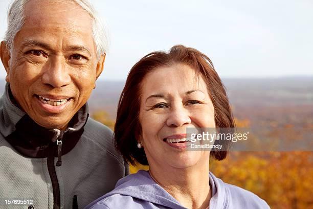 Happy Senior Asian Couple in Autumn
