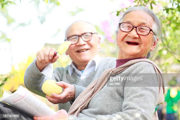 happy senior asian couple in the garden