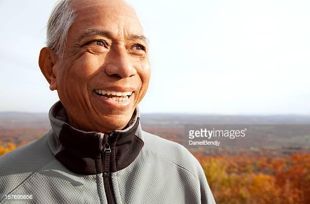 Happy Senior Asian Man in Autumn