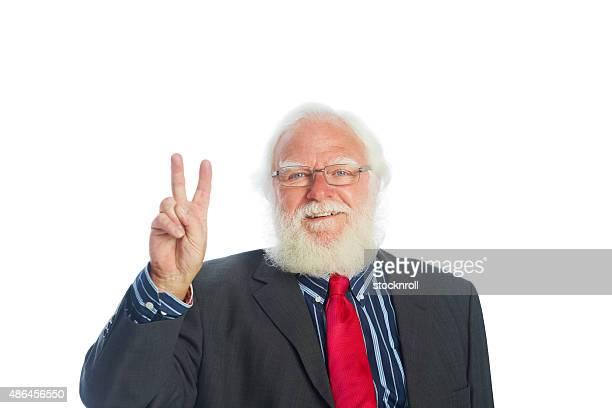 Happy senior businessman with peace symbol