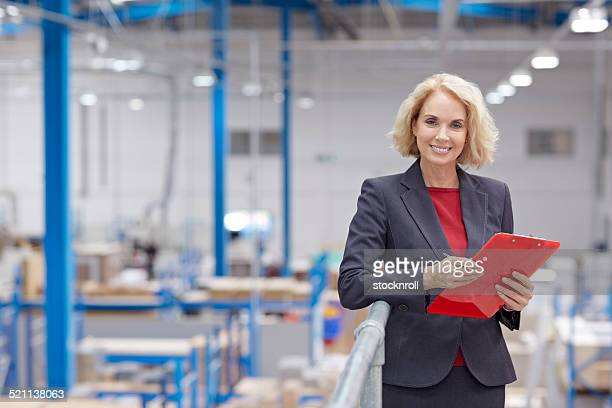 Happy senior businesswoman working in warehouse
