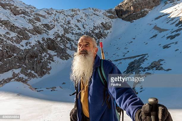 Happy Senior Climber with Long Beard, Kanin, Julian Alps, Europe.