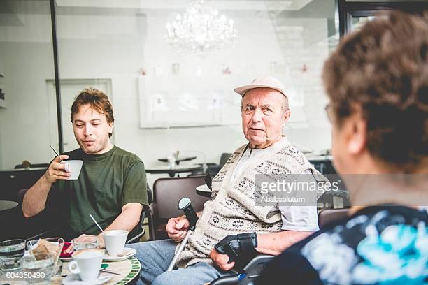 Happy Senior Couple and Grandson Having Coffee, Europe