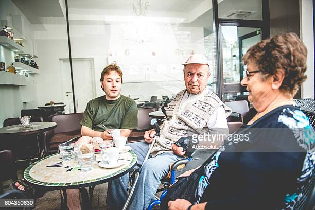 Happy Senior Couple and Grandson Having Coffee, Slovenia, Europe