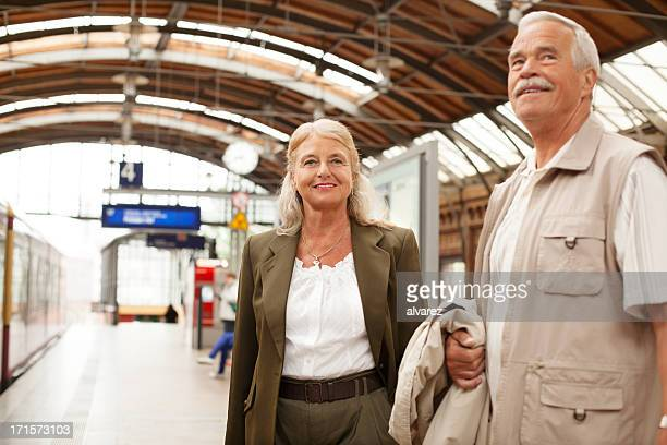 Happy senior couple at train station in berlin