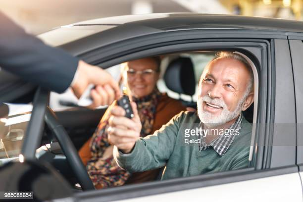 happy senior couple buying a car. - new stock pictures, royalty-free photos & images