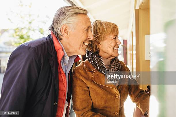 happy senior couple buying tickets at musical theater - hygiaphone photos et images de collection