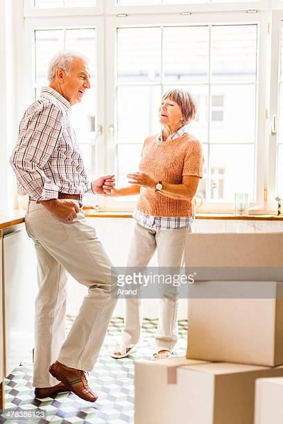 Happy senior couple dancing at kitchen
