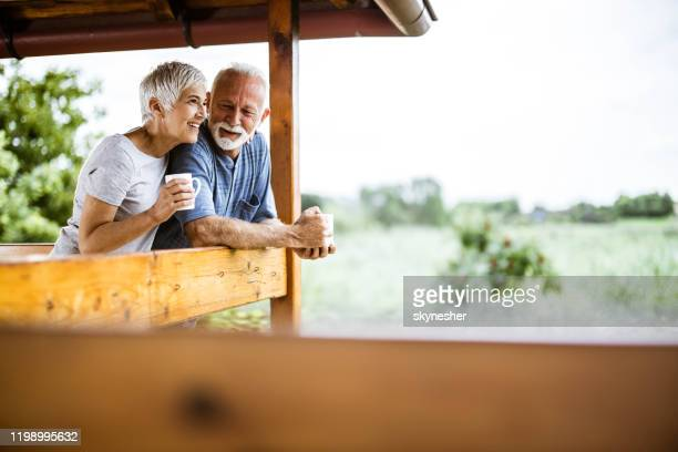 happy senior couple enjoying in morning coffee on a terrace. - weekend activities stock pictures, royalty-free photos & images