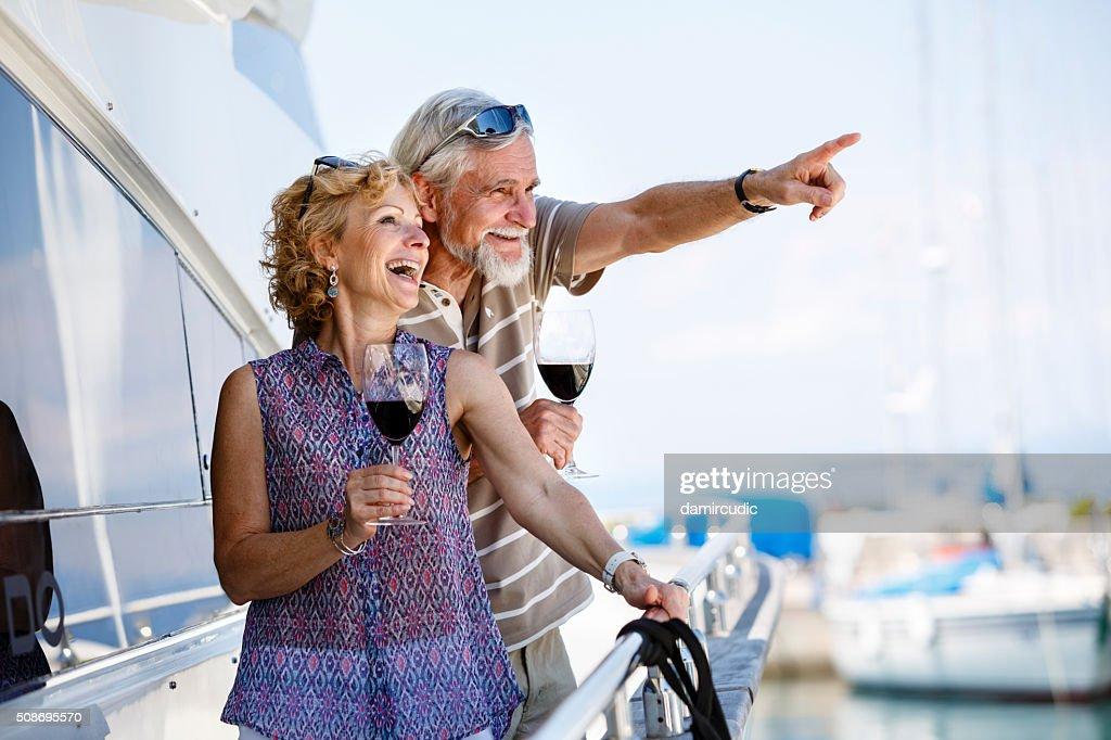 Happy senior couple enjoying wine on yacht : Stock Photo