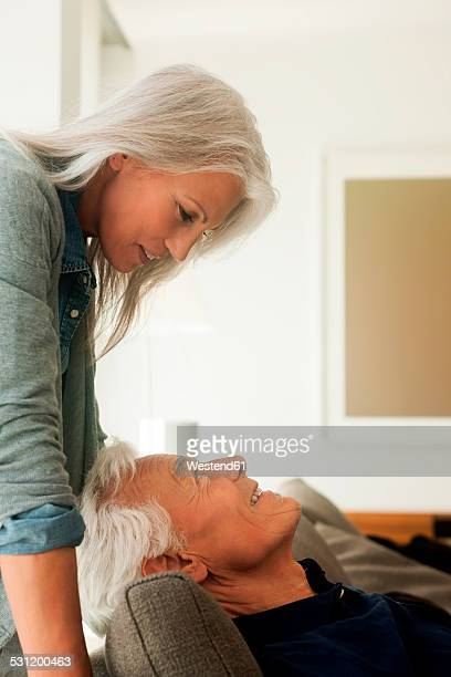 happy senior couple face to face - older woman bending over stock pictures, royalty-free photos & images