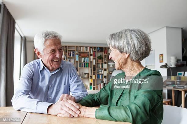 Happy senior couple having fun at home