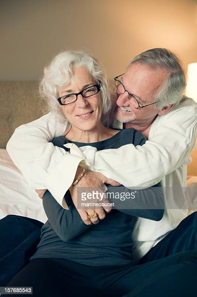 "happy senior couple in hotel bedroom - ""martine doucet"" or martinedoucet bildbanksfoton och bilder"