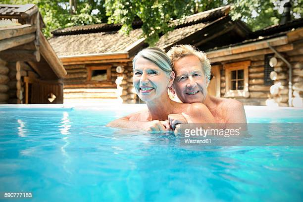 Happy senior couple in swimming pool at a spa