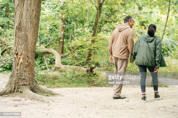 happy senior couple in the forest - simple living stock pictures, royalty-free photos & images