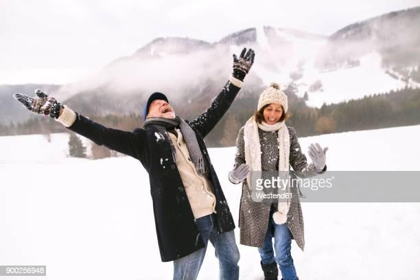Happy senior couple in the snow