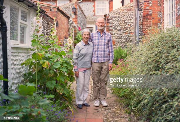 happy senior couple of holiday - cottage stock pictures, royalty-free photos & images