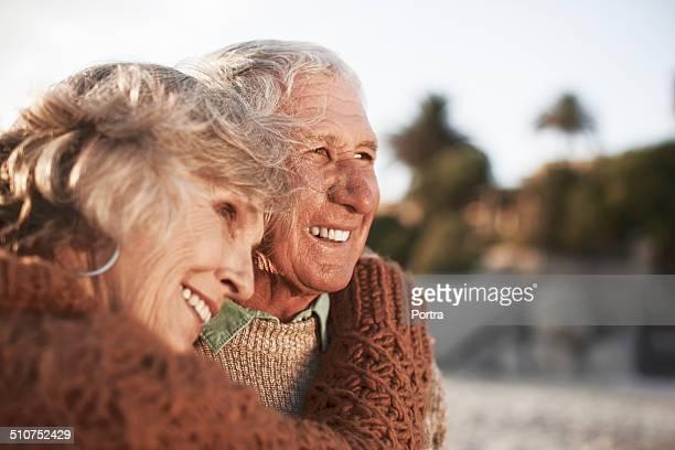 Happy senior couple on beach
