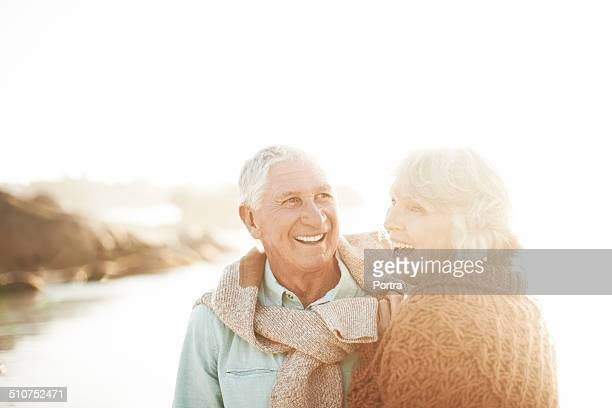 Happy senior couple on beach