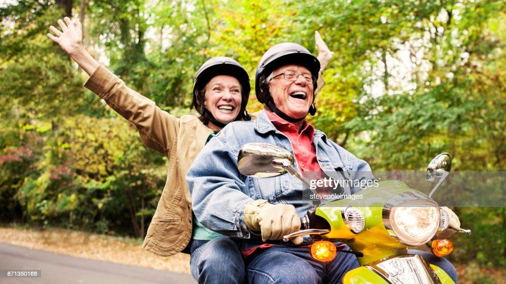 Happy Senior Couple on Scooter : Stock Photo