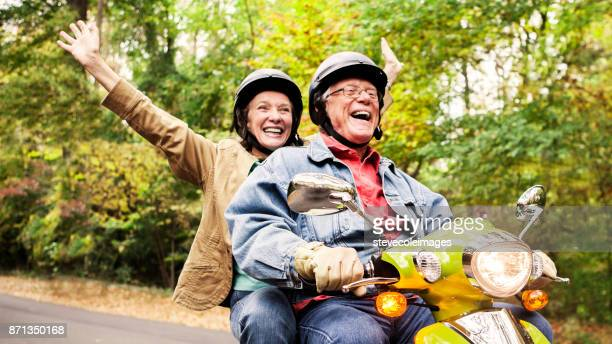 Happy Senior Couple on Scooter