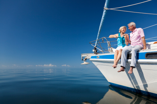 Happy Senior Couple on the Bow of a Sail Boat 136360322