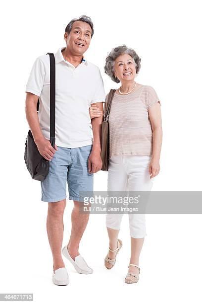Happy senior couple on the move