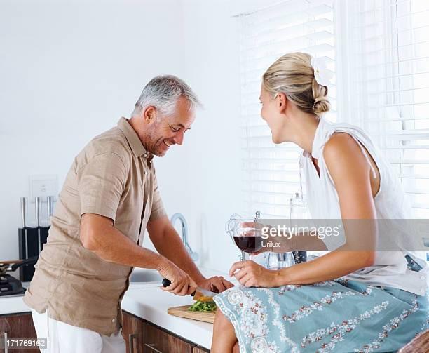 Happy senior couple preparing food in the kitchen