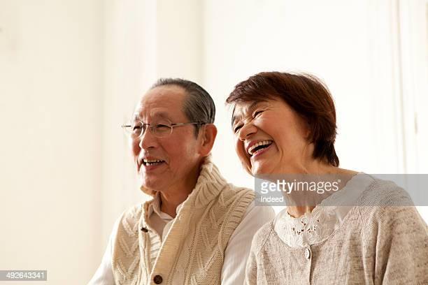 happy senior couple smiling, looking away - 60代 ストックフォトと画像