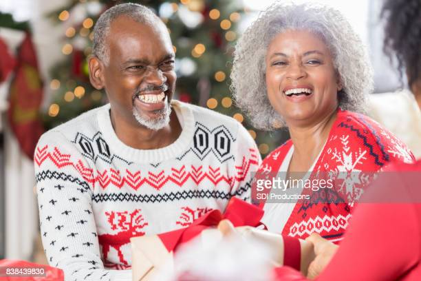 Happy senior couple spend Christmas with family