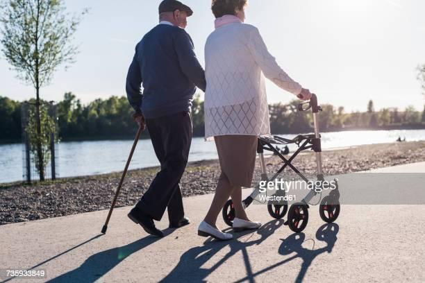 Happy senior couple strolling near river