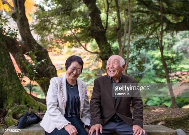 Happy senior couple taking a break in forest