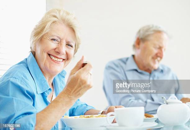 Happy senior couple together having breakfast in the morning