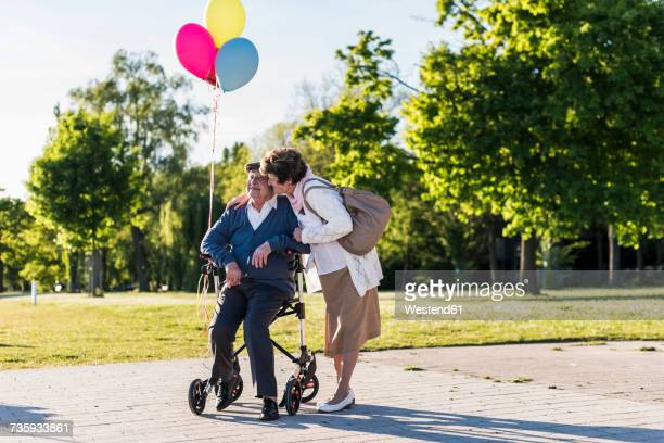 Happy senior couple with balloons