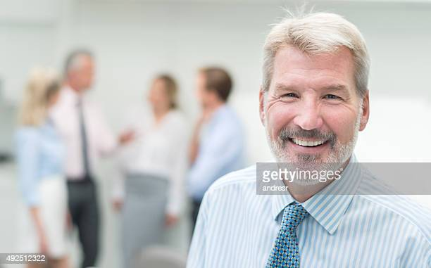 Happy senior executive in a business meeting