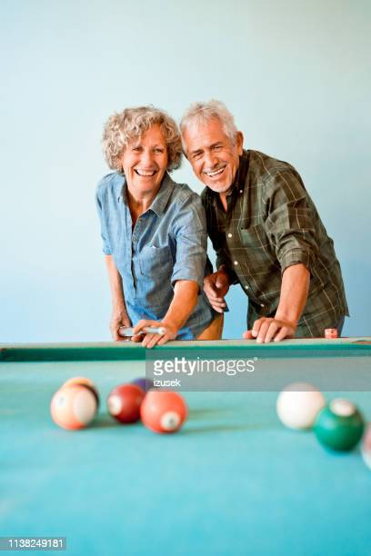 happy senior friends playing pool ball together - old men playing pool stock pictures, royalty-free photos & images