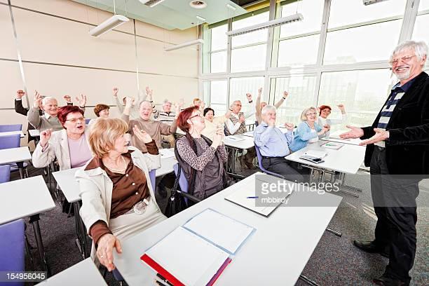 Happy senior group on business seminar