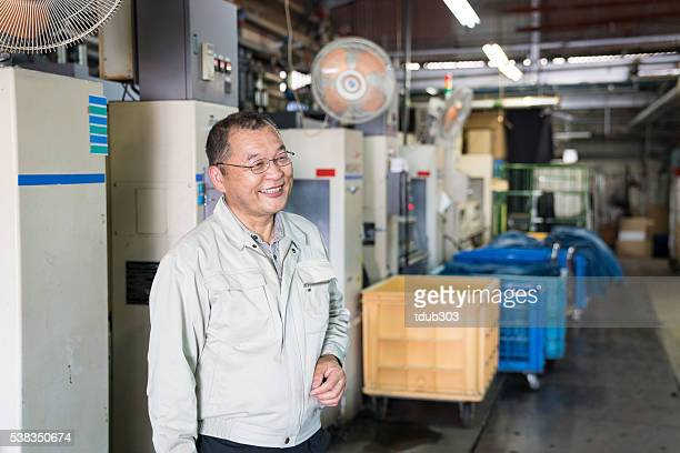 Happy senior industry manager in his textile factory