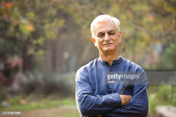 happy senior man at park - indian ethnicity stock pictures, royalty-free photos & images
