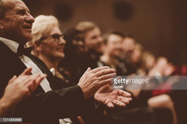 happy senior man clapping in the theater, focus on hands - applauding stock pictures, royalty-free photos & images
