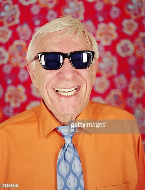 Happy senior man in sunglasses