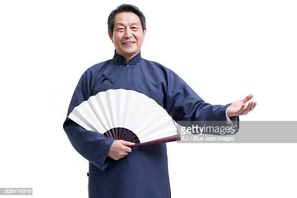 Happy senior man in traditional clothing